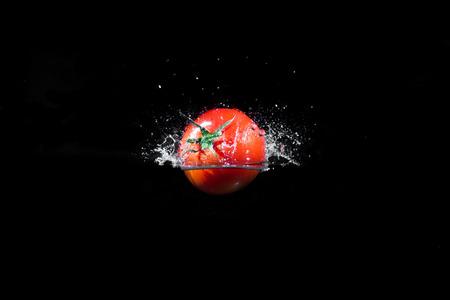 Fresh Red Tomatoes Splash in Water photo
