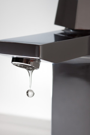 close fitting: Water wastage through leaky faucet Stock Photo