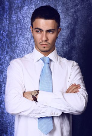 Young handsome business man on blue background. Photo. Stock Photo - 5604981