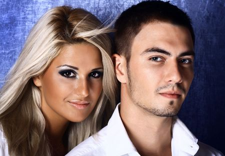 Young love couple smiling. Over blue background. Photo. Stock Photo - 5605145