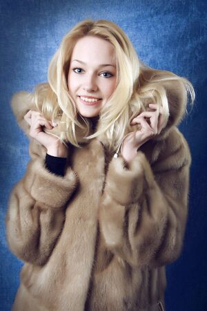 fur hood: Smiling Winter Woman. Photo.  Stock Photo