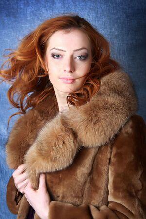 Beautiful woman in expensive fur. Winter fashion & makeup. Photo.  photo