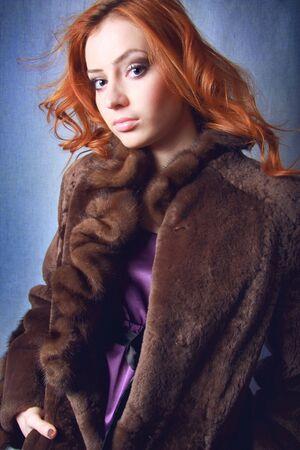 Beautiful woman in expensive fur. Winter fashion & makeup.  photo