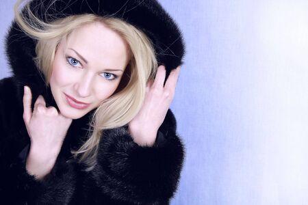 Beautiful woman in winter fur coat. Photo.  photo