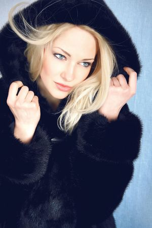 fur hood: Beautiful woman in winter fur coat. Photo.