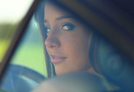 Portrait of girl through automobile glass. Photo. photo