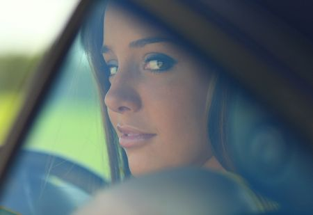 see through: Portrait of girl through automobile glass. Photo. Stock Photo