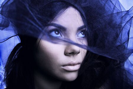 East woman peeking out from behind veil. Photo. Stock Photo - 5604933