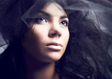 portrait of a young beautiful woman in the veil. Photo. photo