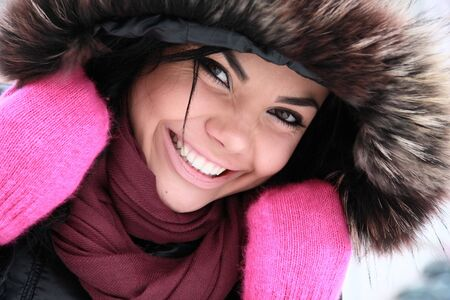 positive young girl in pink gloves. Photo.