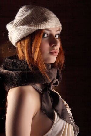 Beautiful redhead young woman with scarlet lips Stock Photo - 5632821