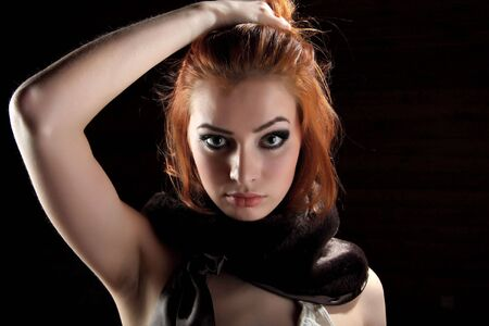 Sexy redhead young woman. Stock Photo - 5633406