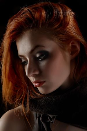 Beautiful redhead young woman with scarlet lips. Stock Photo - 5633002