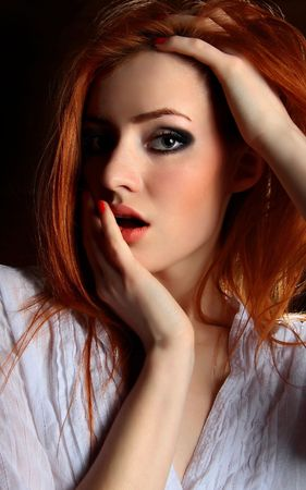 Sexy redhead young woman. . Stock Photo - 5633035