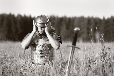 One Roman soldier in field. No war concept photo