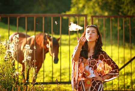 Modern rural girl. Country lifestyle. photo