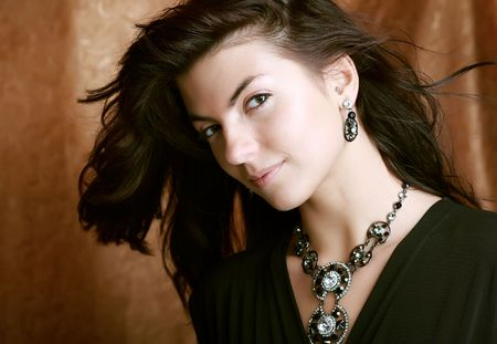 Improbably beautiful lady in expensive necklace on her neck  photo