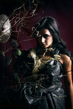 paranormal: Stylised witch in bushes and dangerous sharp tools. Halloween