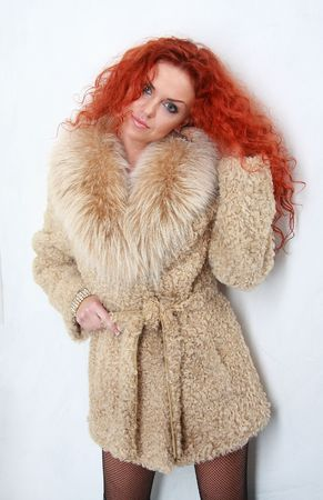 Beautiful woman in expensive fur. photo