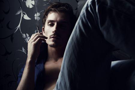 태도: Portrait of handsome elegant man with cigarette. Photo. 스톡 사진