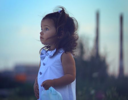air pollution: Little girl against power station. Stock Photo
