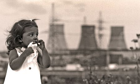 Little girl against power station. photo