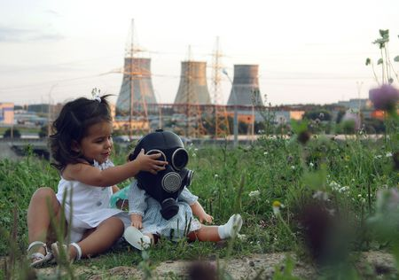 power station: Little girl against power station. Stock Photo