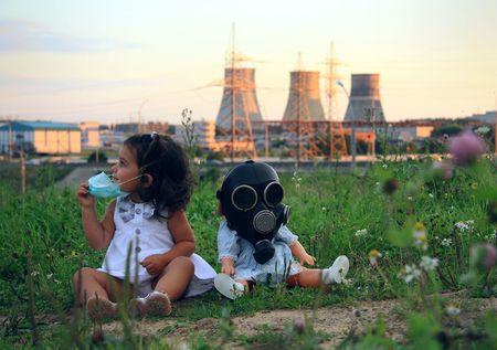 Little girl against power station. photo