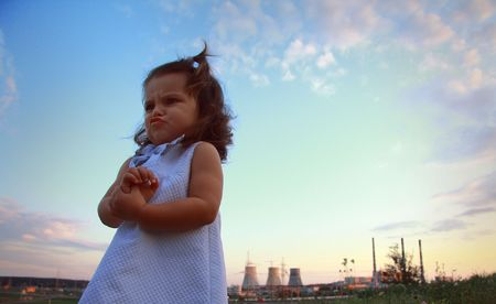 heritage protection: Little girl against power station. Stock Photo