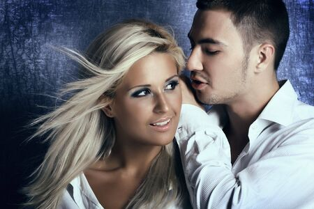 Young love couple smiling. Over blue background.  photo
