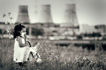 power station: Innocent child in a respiratory mask with a doll in her hands walking against power station polluting air. Ecological theme.