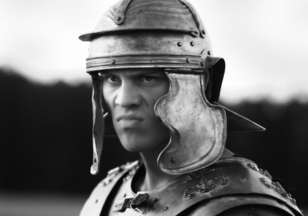 agressive Roman soldiers. Close-up face. photo