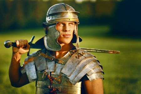 roman soldier: One Brave Roman soldier in field. Stock Photo
