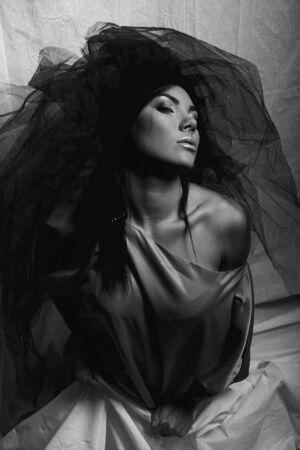 Under a veil of secrecy. Beautiful woman. Fashion art photo