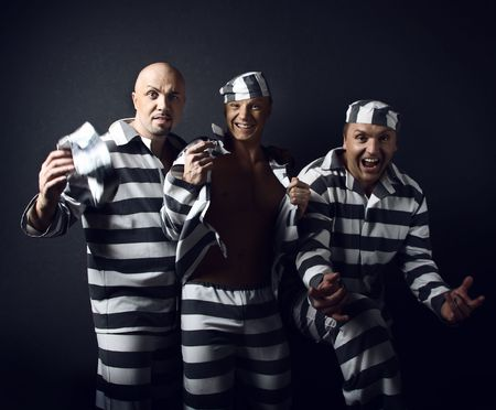Three prisoners. Group of men in suits of convicts.  photo