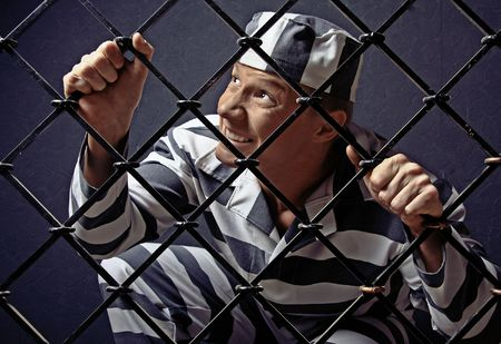 man of an athletic constitution in suit of prisoner. Stock Photo - 5776327