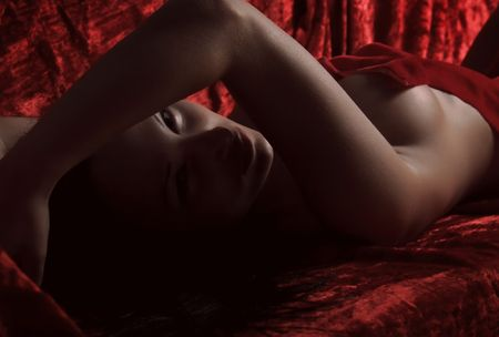 very sexy woman covered with red silk sheet Stock Photo - 5812949