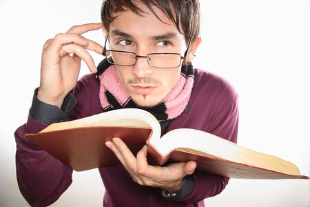 expressional: young nice student with  red book in hands