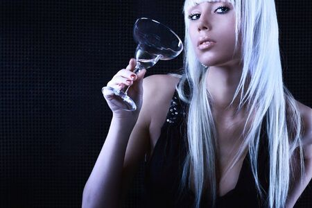 Studio shot of a young, beautiful, blond, fashionable woman Stock Photo - 5848194