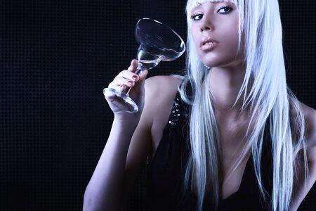 Studio shot of a young, beautiful, blond, fashionable woman photo