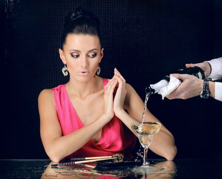 Young sexy girl drinking champagne and eating fish Stock Photo - 5881888
