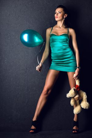 young attractive sexual girl with toys photo