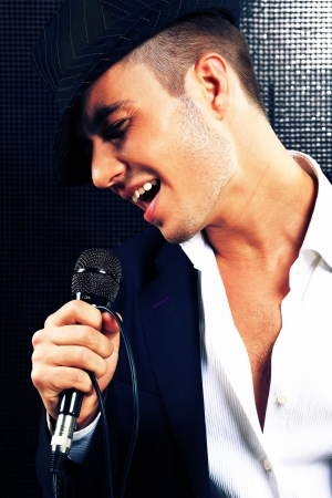 young attractive singer on dark background