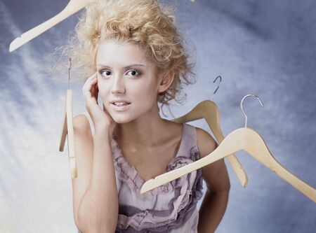 Winter Girl with beautiful make up with flying hangers photo