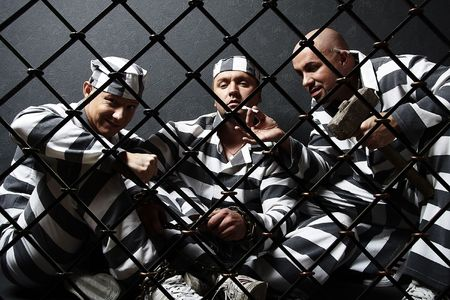 infringement: Three prisoners. Group of men in suits of convicts. Stock Photo