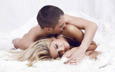 Beautiful young couple in the bedroom photo