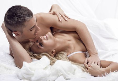 Beautiful young couple in the bedroom Stock Photo - 5983493