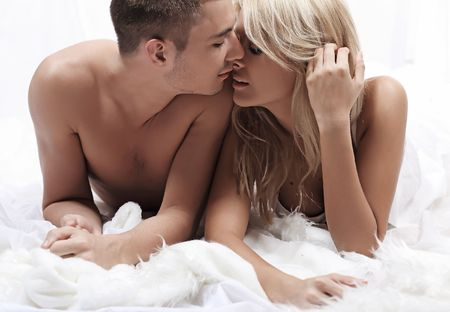 loving couple: Beautiful young couple in the bedroom