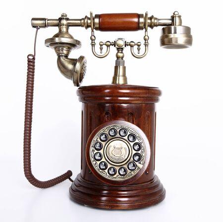 Vintage retro style phone isolated on white background photo