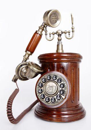 Vintage retro style phone isolated on white background